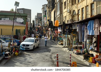 ISTANBUL, TURKEY - OCTOBER 06, 2020. Street market and dilapidated houses in the commercial quarter Karakoy in the Beyoglu district of Istanbul, Turkey.