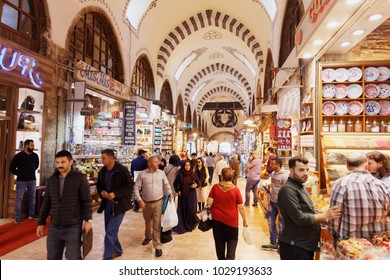 ISTANBUL, TURKEY - OCTOBER 13, 2017: People in the Spice Bazaar. It's the second largest covered shopping complex in the city after the Grand Bazaar