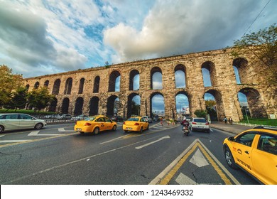 ISTANBUL, TURKEY - October 13, 2018: Ataturk Boulevard and Ancient roman Aqueduct of Valens. It was built by the emperor Valens in the late 4th century, one of the most important landmarks of the city