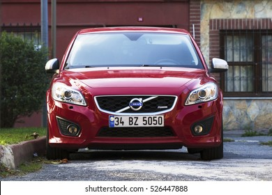 Istanbul, Turkey - October 16, 2016: New Red Volvo at the Istanbul Streets in a sunny day in front of houses in a district. There is nobody in the car.