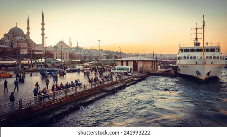 ISTANBUL, TURKEY - OCTOBER 24, 2014 : View on Eminonu pier in sunset in Istanbul, Turkey. Toned image.