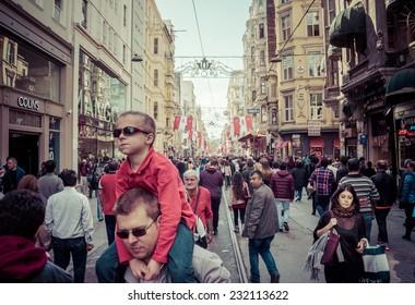 ISTANBUL, TURKEY - OCTOBER 25, 2014 : People walking on Taksim Istiklal Street , a popular tourist destination in Istanbul. Toned image