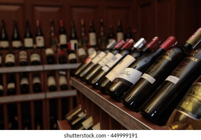 ISTANBUL, TURKEY - OCTOBER 25: Wine room with bottles on wooden shelves in Turkish restaurant on October 25, 2013 in Istanbul, Turkey.