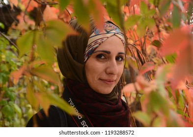 Istanbul, Turkey - October 28, 2017: Fashion portraiture of young beautiful muslim woman wearing hijab. Image contain certain grain or noise and soft focus. Hijab Woman in Nature (Editorial)