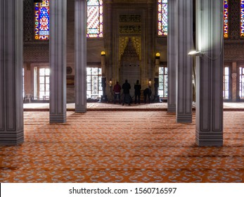 Istanbul, Turkey - October 30, 2019: People praying in the Sultan Ahmed Mosque (or The Blue Mosque).