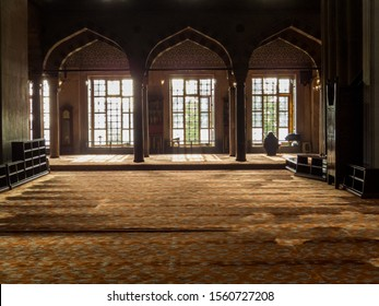 Istanbul, Turkey - October 30, 2019: Person praying in the Sultan Ahmed Mosque (or The Blue Mosque).