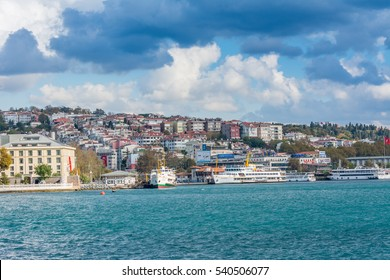 Istanbul, Turkey, October 31, 2016 Editorial: Modern buildings  and ancient architecture along the Bosphorus strait in Istanbul Turkey from ferry on a sunny day with background of cloudy sky