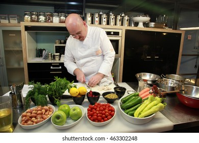 ISTANBUL, TURKEY - OCTOBER 9: A Turkish chef cooking at restaurant kitchen on October 9, 2013 in Istanbul, Turkey.