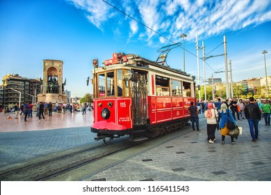ISTANBUL, TURKEY: Old-fashioned red tram at Taksim square - the most popular destination in Istanbul. Nostalgic tram is the heritage tramway system, on April 26, 2018