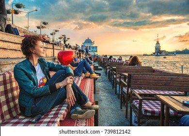 Istanbul, Turkey: People are spending leasure time at cafe and meeting sunset with view of Maiden's tower in Uskudar on October 3, 2017