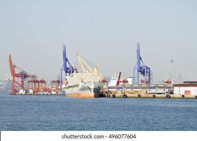 Istanbul, Turkey - Sepember 30, 2016 : Cranes and freight vessel in Haydarpasa port.The harbor gives loading and unloading services to the vessels.