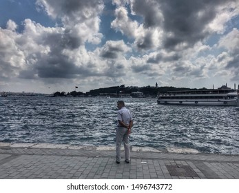 ISTANBUL - TURKEY, September 05, 2019: Lonely man. watching the sea. Karakoy coastline.