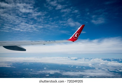 ISTANBUL, TURKEY - September 10, 2017: Wing of an airplane modeled Boeing 737-800 belonging to Turkish Airlines flying over a blue and cloudy sky.