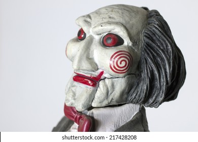 Istanbul, Turkey - September 14, 2014: Jigsaw's little puppet. Saw is a horror film franchise distributed by Lions Gate and produced by Twisted Pictures that consists films and additional merchandise.
