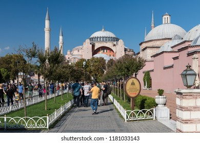 ISTANBUL, TURKEY, SEPTEMBER 14, 2018: People walking at Sultanahmet Square, Hagia Sophia can be seen at the background. Sultanahmet District is the heart of old Istanbul.