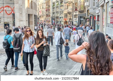 Istanbul, Turkey- September 18, 2017: Many citizens and tourists walking on a street in Istanbul full of typical shops