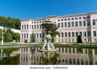 ISTANBUL, TURKEY, SEPTEMBER 19,2018: Fountain inside Dolmabahce Palace gardens, famous landmark situated at the coastline of Besiktas district of Istanbul, Turkey.