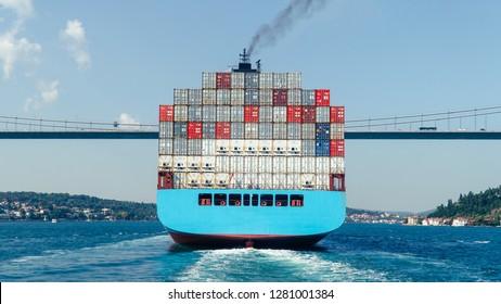 Istanbul, Turkey - September 2018: Cargo ship tanker in Bosphorus Strait about to pass under Bosphorus bridge