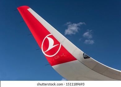 ISTANBUL, TURKEY - SEPTEMBER 21, 2019: Turkish Airlines logo symbol on the tails of a Turkish Airlines airplane. Turkish Airlines is the largest airline of Turkey with its headquarters in Istanbul.