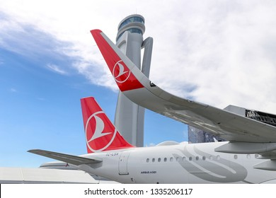 ISTANBUL, TURKEY - SEPTEMBER 23, 2018: Turkish Airlines Airplane in front of control tower of Istanbul New Airport