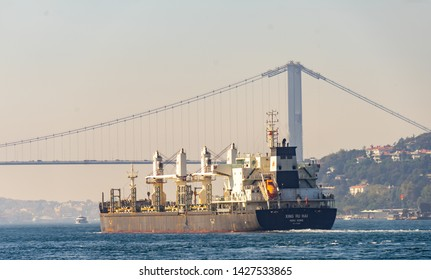 Istanbul, Turkey, September 23., 2018: The ship Xing Ru Hai, a Chinese bulk carrier, under the Bosporus Bridge on its way from the Mediterranean to the Black Sea