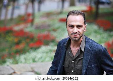 ISTANBUL, TURKEY - SEPTEMBER 24: Famous Turkish actor, thespian and tv series star Serdar Orcin portrait on September 24, 2013 in Istanbul, Turkey.