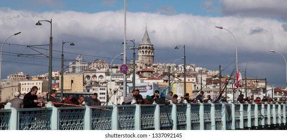 ISTANBUL, TURKEY - SEPTEMBER 25: People fishing on the Galata Bridge in Eminonu Coastline on September 25, 2013 in Istanbul, Turkey.