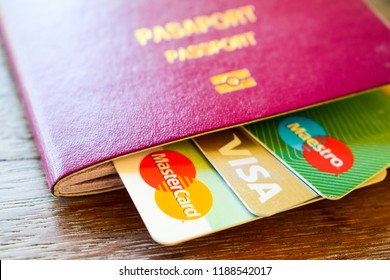 Istanbul, Turkey - September 26, 2018: Credit cards, master card, visa card and maestro card in the Turkish passport. Financial travel budget plan concept for vacation.