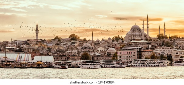 ISTANBUL, TURKEY - SEPTEMBER 28, 2013: Looking towards the Suleymaniye mosque from the Galata Bridge with passenger ships arriving to the port.