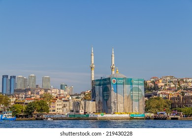 ISTANBUL, TURKEY - SEPTEMBER 29, 2013: View of the Ortakoy Mosque in restoration sailling Bosporus.
