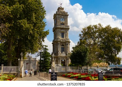 Istanbul, Turkey - September 3, 2018: The Dolmabahce Clock Tower, located at the entry of the Dolmabahce Palace. Besiktas district. Istanbul, Turkey