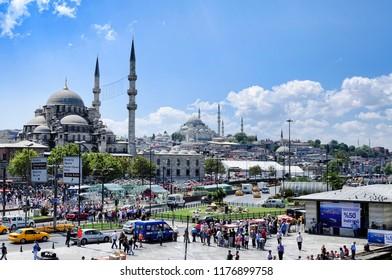 Istanbul, Turkey - September 5, 2018: View over the boats Eminonu and the Suleymaniye Mosque (Suleymaniye Camii) People at Eminonu square