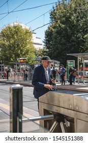 ISTANBUL, TURKEY -  SEPTEMBER 5: Random click of a elderly man waiting for his train at Sultan Ahmed street