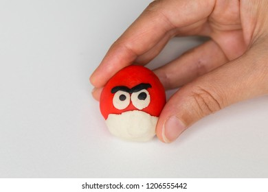 Istanbul / Turkey -September 7, 2018 ; step by step making red angry bird with play dough for children's education activity in the school,nursery or kindergarten lesson Plasticine concept.