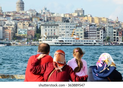 ISTANBUL, TURKEY - SEPTEMBER 7: A Turkish family is looking at the Bosporus on September, 7, 2014 in Istanbul, Turkey