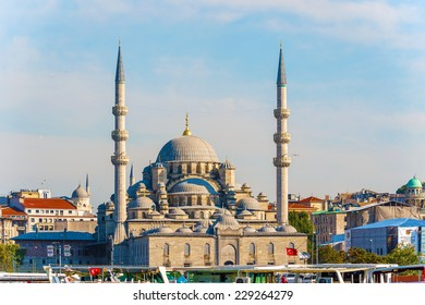 Istanbul, Turkey - September10, 2014: Tourists visiting meaning New Mosque is an Ottoman imperial mosque. It is one of the famous architectural landmarks of Istanbul.