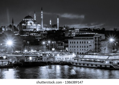 Istanbul, Turkey-February 16, 2019 ; Black and White Yeni Cami, The New Mosque with Egyptian bazaar at night in Istanbul.