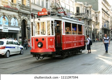 ISTANBUL, TURKEY-JULY 28, 2011:  Taksim Tram rumbles through the center of the entertainment, culture and shopping pedestrian street on Istiklal Avenue.