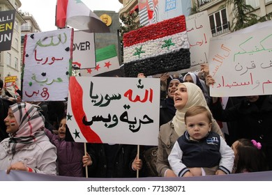 ISTANBUL, TURKEY-MAY 13: Unidentified Syrians living in Istanbul and Civil Society Organizations protest the regime of Bashar Essad in front of Syrian Consulate building on May 13, 2011 in Istanbul, Turkey.