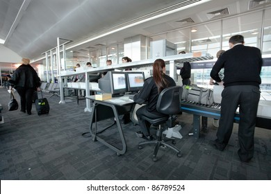 ISTANBULE - MARCH 22: Ataturk airport security staff check passenger bags at gate on March 22, 2011 in  Istanbul, Turkey. Ataturk is a major international airport in Turkey, located on European side, it opened in 1924.