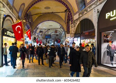 ISTANBUL,FEBRUARY 4, 2017: Tourists visiting interior corridor of Grand Bazaar in Istanbul-Turkey. One of the largest and oldest covered markets in world. A variety of Turkish items for sale at Grand Bazaar