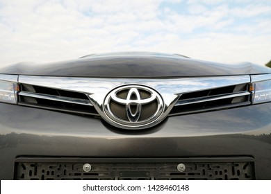 ISTANBUL-JUNE 19, 2019: Brown Toyota car, big logo close-up on over front grille.