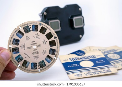 Istanbul/Turkey - 04.11.2019: View Master, retro 3D photo viewer and it's reel on white background
