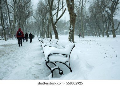 Istanbul,Turkey - 07 January 2017 : people walking in the snowy Park
