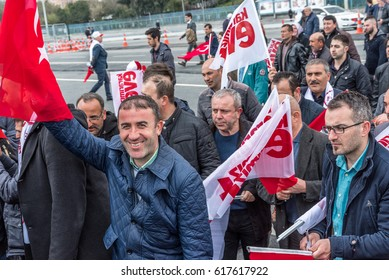 ISTANBUL/TURKEY- APRIL 08,2017: AKP (Justice and Development Party) supporters shout slogans and wave party flags during a yes referendum /plebiscite campaign rally in Istanbul, Yenikapi meeting area.