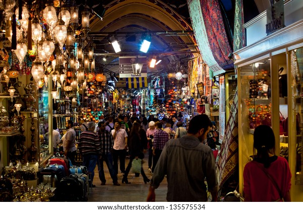 ISTANBUL,TURKEY - APRIL 13: Tourists visiting Grand Bazaar on April 13, 2013 in Istanbul, Turkey. Istanbul Grand Bazaar is one of the world's most exciting shopping experiences.
