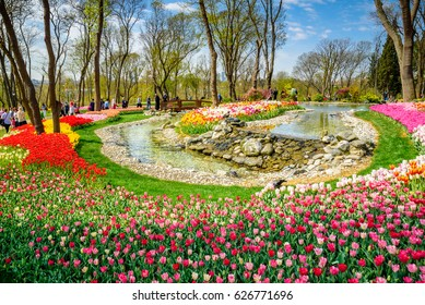ISTANBUL/TURKEY- APRIL 15,2017: Traditional Tulip Festival in Emirgan Park, a historical urban park located in the Sariyer district of Istanbul, Turkey. Tourists visit and spend the weekend.
