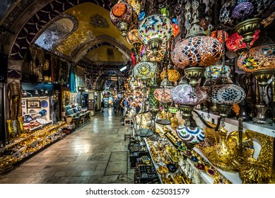 ISTANBUL/TURKEY- APRIL 17,2017:Unidentified Tourists visiting and shopping in the Grand Bazaar in Istanbul. Interior of the Grand Bazar.