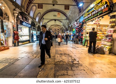 ISTANBUL/TURKEY- APRIL 17,2017:Unidentified Tourists visiting and shopping in the Grand Bazaar in Istanbul. Interior view of the Grand Bazaar.