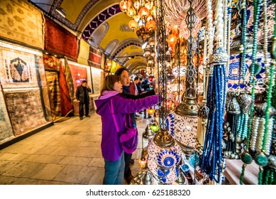 ISTANBUL/TURKEY- APRIL 17,2017:Unidentified Tourists visiting and shopping in the Grand Bazaar in Istanbul.It is one of largest and oldest covered markets in the world, Interior of the Grand Bazar.